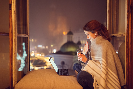 Young Woman At Home Enjoying A Video Call Stock Photo - Download Image Now