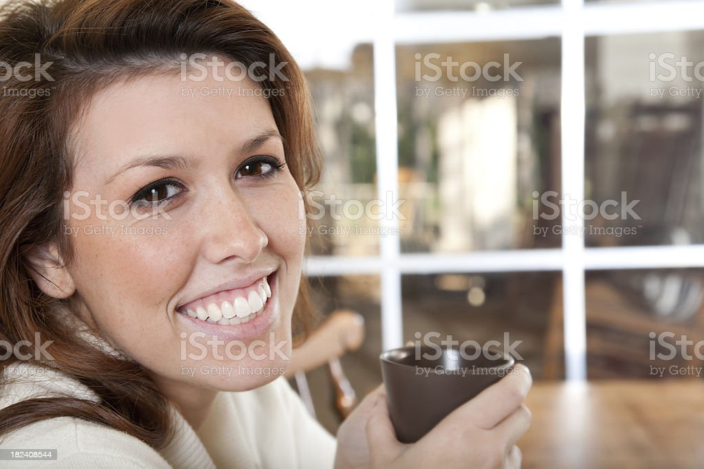 Young Woman at Home Having Tea royalty-free stock photo