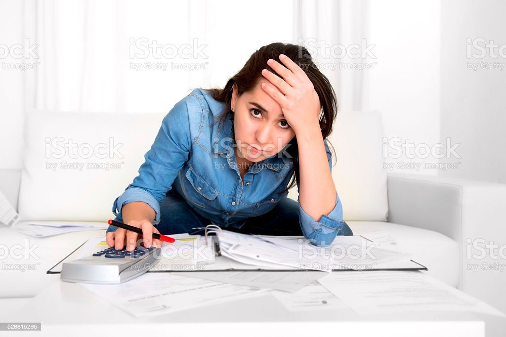 young woman at home in stress desperate in financial problems stock photo