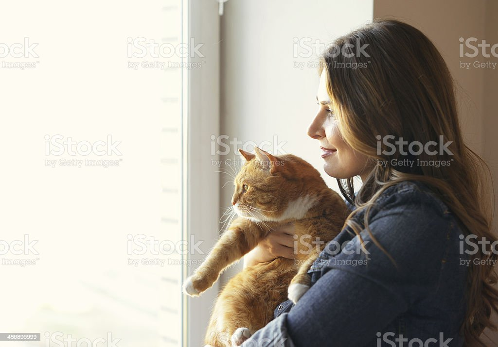 young woman at home stock photo