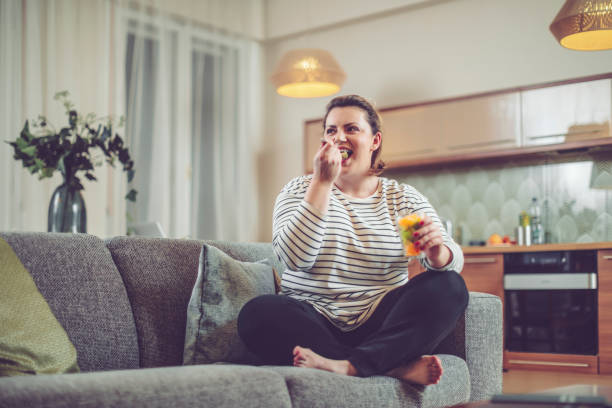 young woman at home - fat nutrient stock photos and pictures