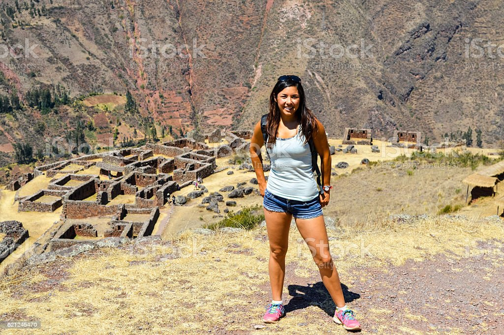 Young woman at Inca Ruins in the Peru stock photo