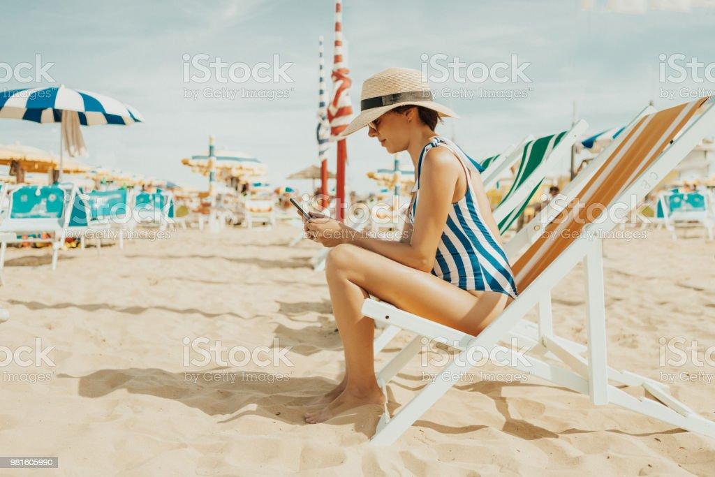 Young woman at italian beach stock photo