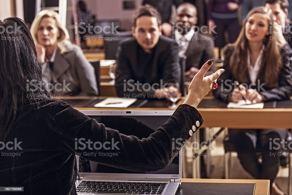 Young Woman at Press Conference Answering stock photo