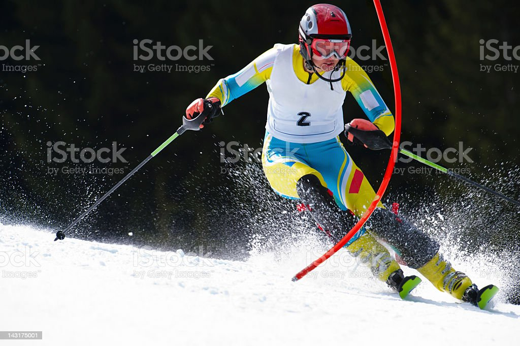 Young woman at slalom ski race stock photo