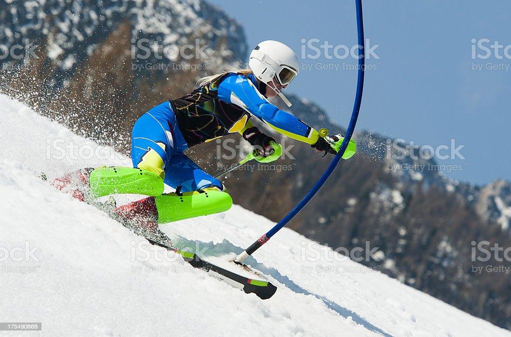 Young woman at slalom ski race stock photo