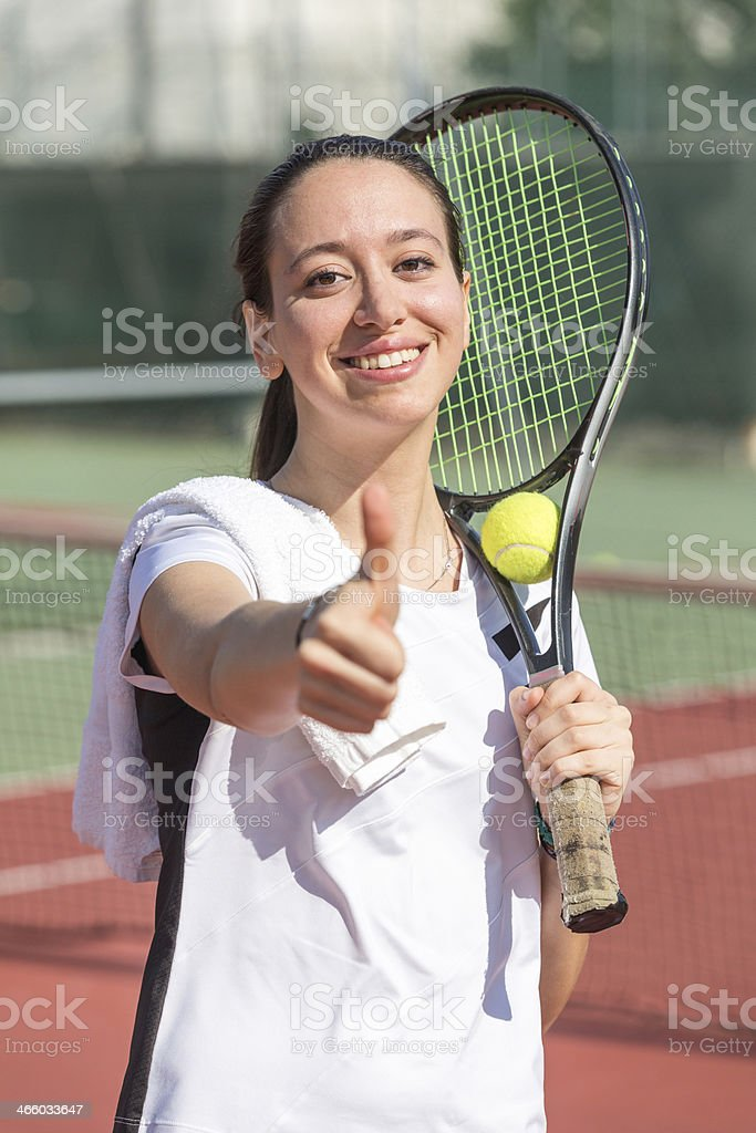 Young Woman at Tennis Court royalty-free stock photo