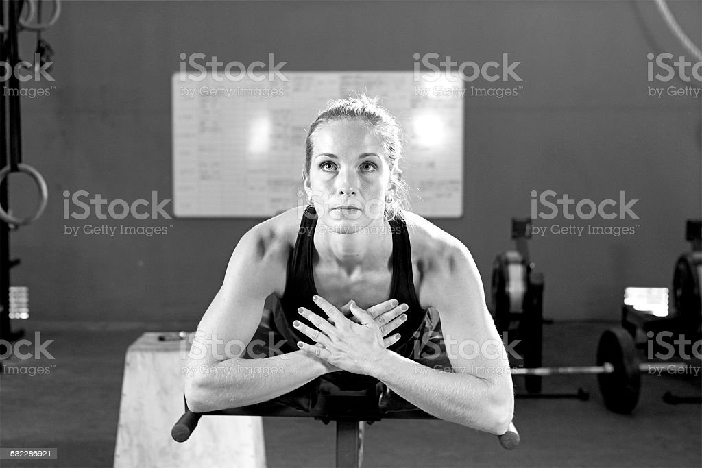 young woman at the abdominal crunch machine - gym workout stock photo
