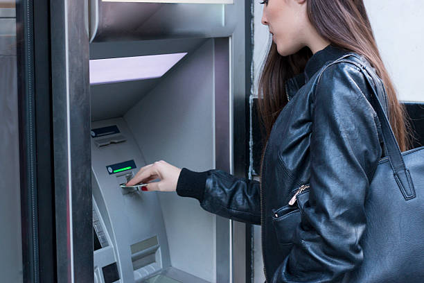 Young woman at the ATM stock photo