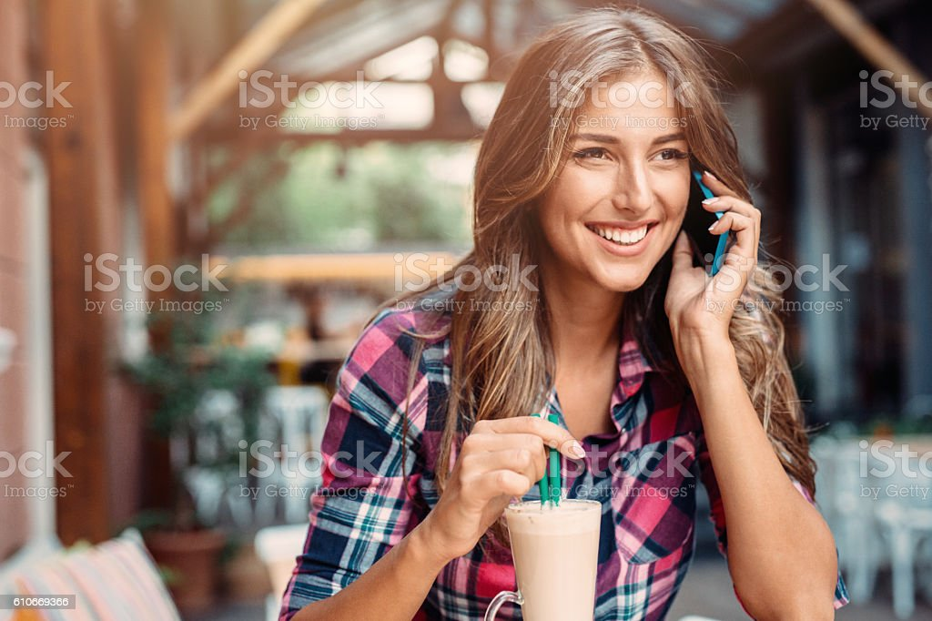 Young woman at the cafe stock photo
