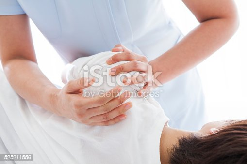 Young woman at the center of the arm are receiving massage