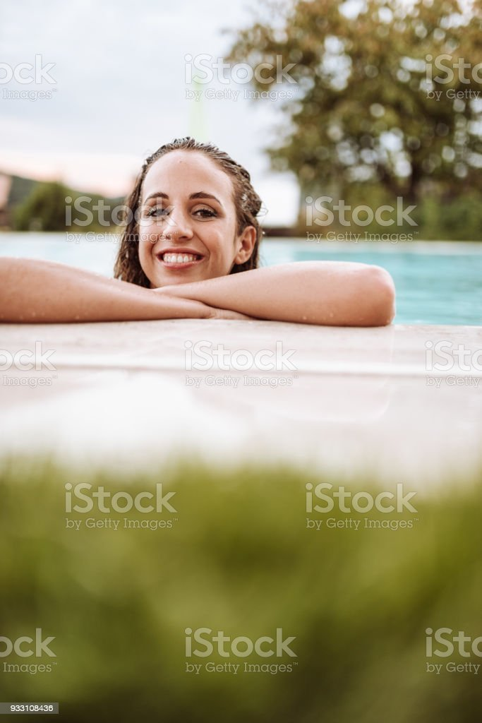 young woman at the edge of the pool