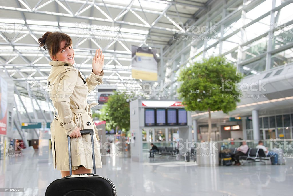 Young woman at the international airport royalty-free stock photo