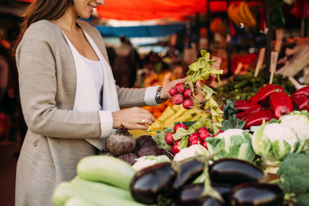 young woman at the market. - farmers market stock pictures, royalty-free photos & images