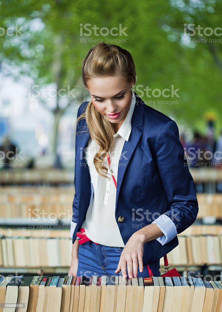Young woman at the street book market stock photo