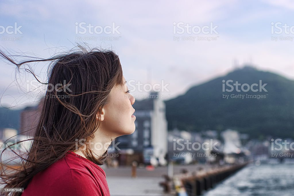 Young Asian woman\' profile at twilight.