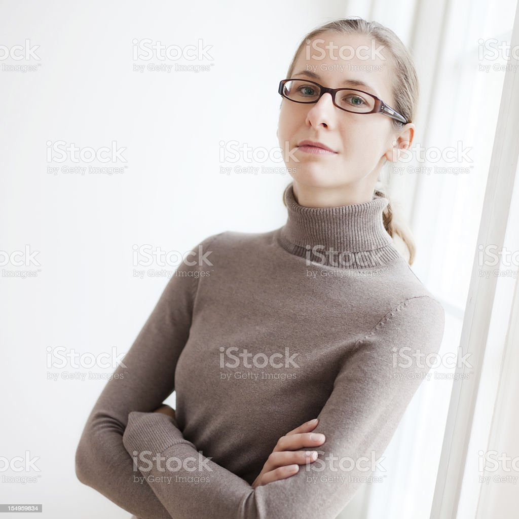Young Woman at Window Sill royalty-free stock photo