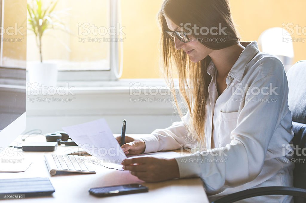 Young woman at work, home office situation stock photo