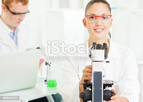 istock Young Woman at work in a lab. 483343237