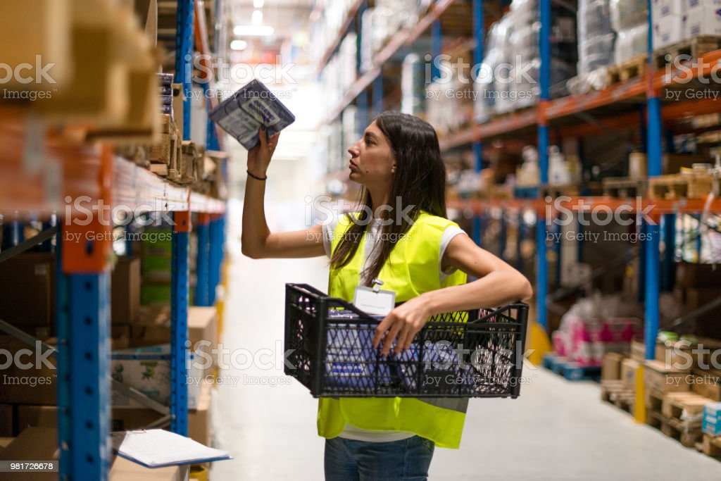 Young woman at working warehouse stock photo