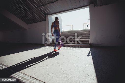istock Young woman athlete on stadium entrance 826093290
