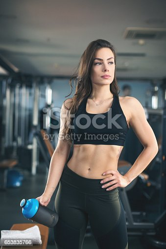 670937518istockphoto Young woman athlete posing for camera 653835766