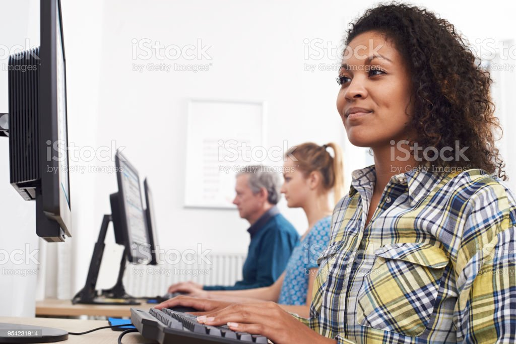 Young Woman Attending Computer Class stock photo