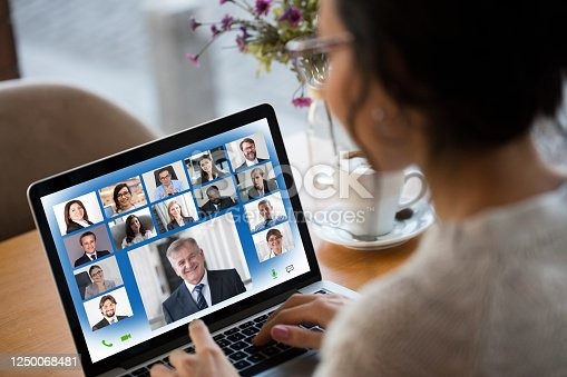 Young Woman Attending Video Conference on laptop computer
