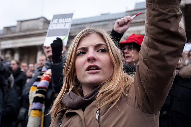 Young woman attends Charlie Hebdo rally stock photo