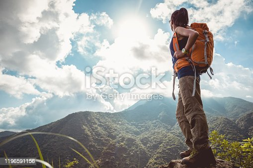 Young woman backpacker enjoy the beautiful view at mountain peak