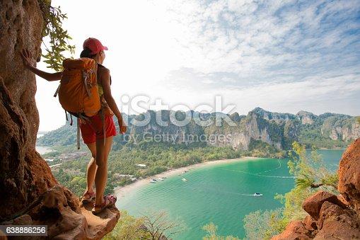 istock young woman backpacker hiking on seaside mountain 638886256