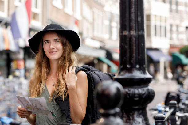 Young Woman Backpacking In Europe stock photo