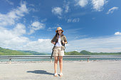 istock Young woman backpacking traveling front view 1273638753