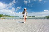 istock Young woman backpacking traveling front view 1276928204