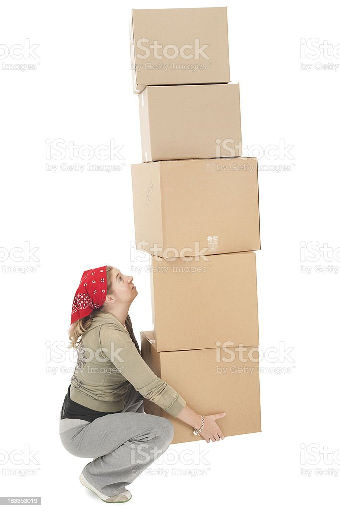 Young Woman Balancing a Stack of Moving Boxes royalty-free stock photo