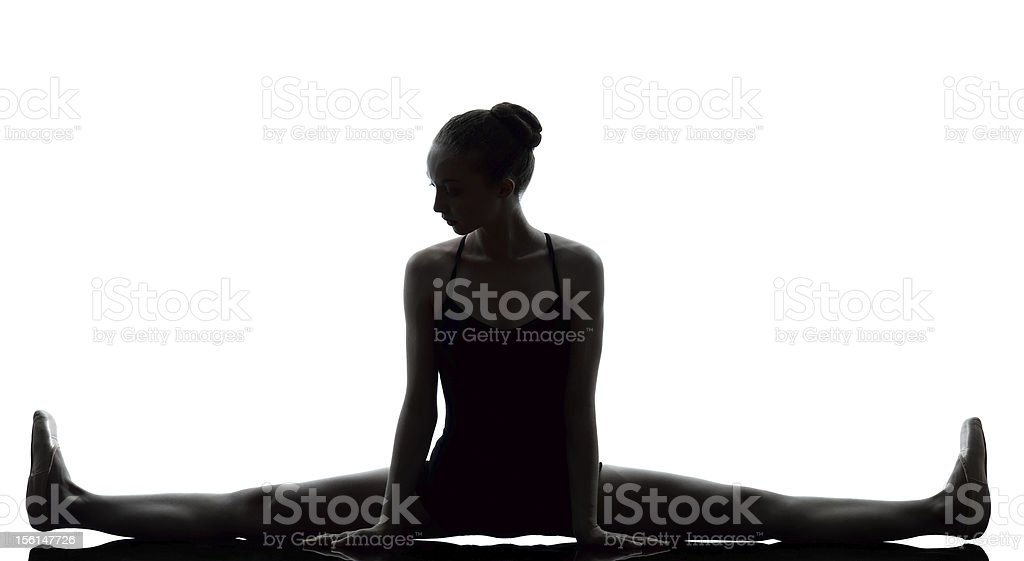 young woman ballerina ballet dancer stretching warming up royalty-free stock photo