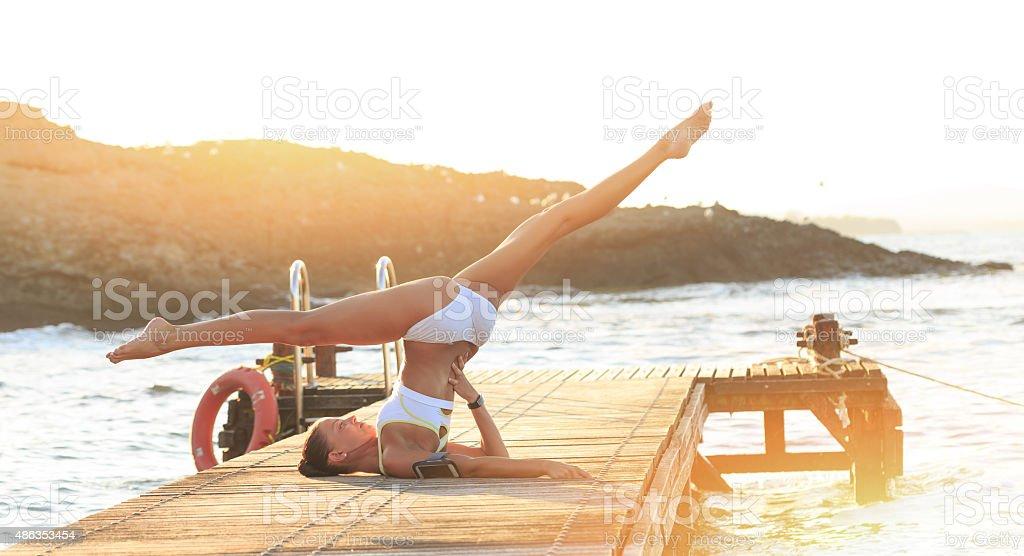 Young Woman Ballet Dancer Demonstrating Yoga Flexibility stock photo