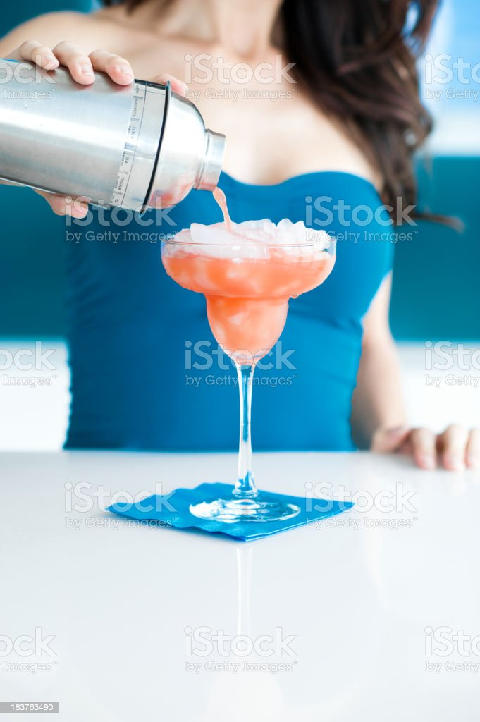 Young Woman Bartender Pouring Margaritas royalty-free stock photo