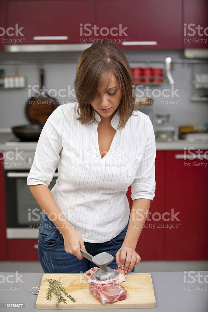 Young woman beating a steak stock photo