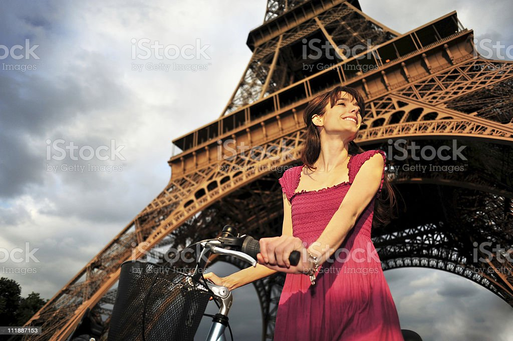 Young Woman Below Eiffel Tower with Bicycle Paris France royalty-free stock photo