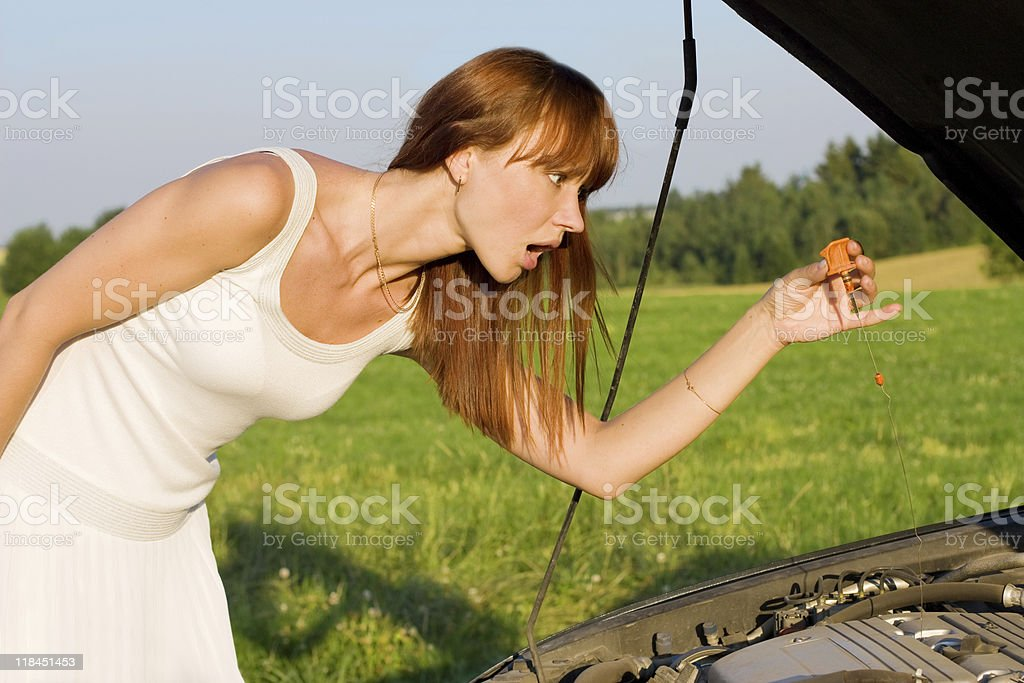 young woman bent over car engine royalty-free stock photo