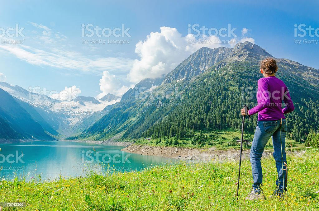 Young woman beside azure mountain lake, Austria stock photo