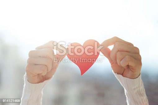 istock Young woman between hand red heart 914121468
