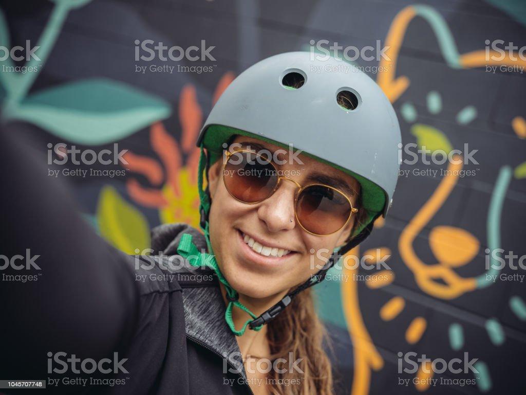 Young woman biking selfie stock photo