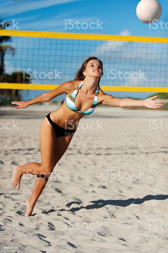 Young Woman Bikini Playing Beach Volleyball stock photo