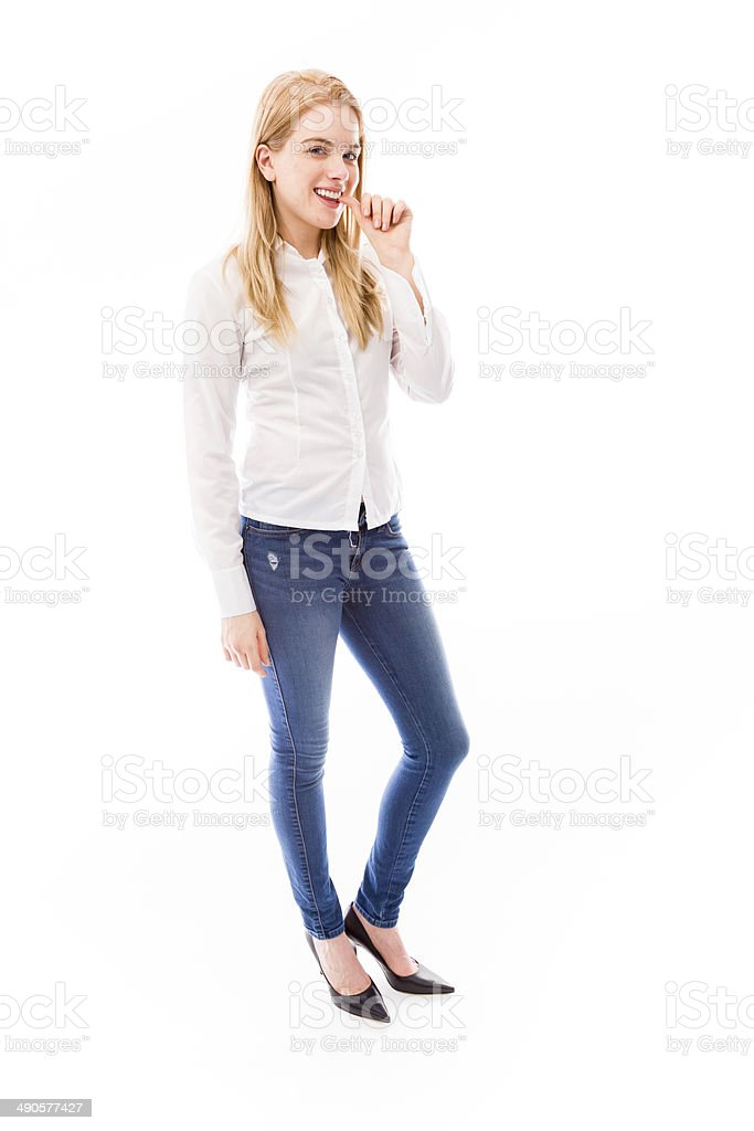 Young woman biting fingernails royalty-free stock photo