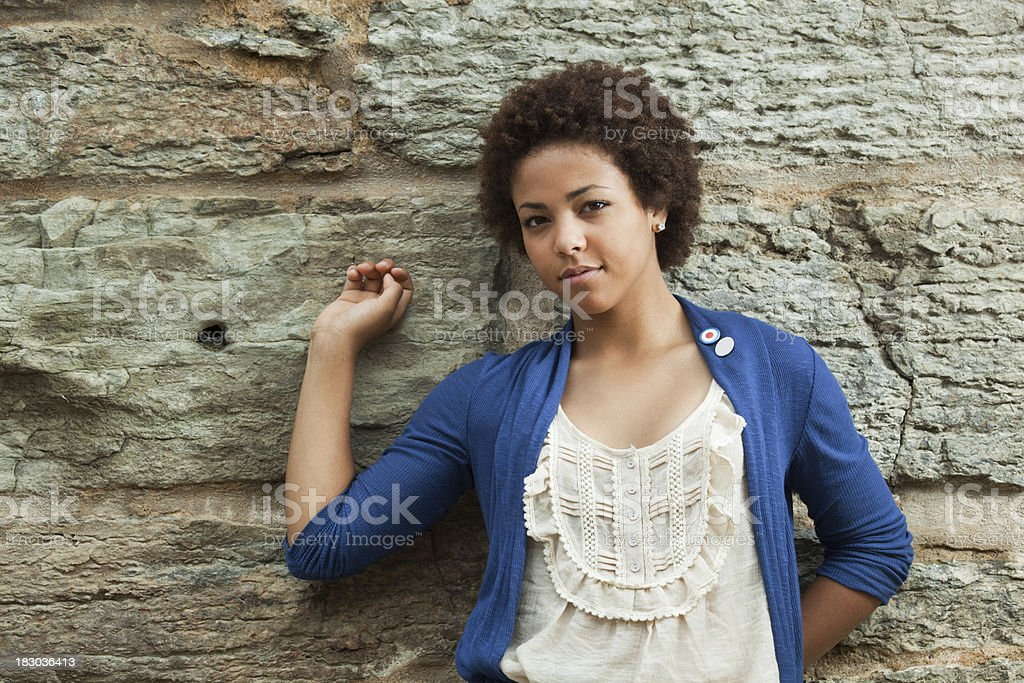 Young Woman, Black Teenage Girl in Blue, Beige by Wall stock photo