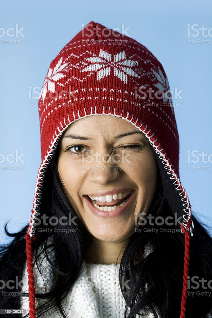 young woman blinking eye at you stock photo