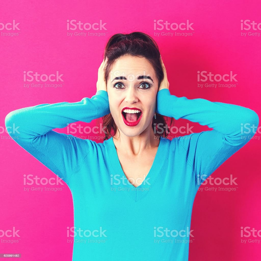 Young woman blocking her ears foto royalty-free