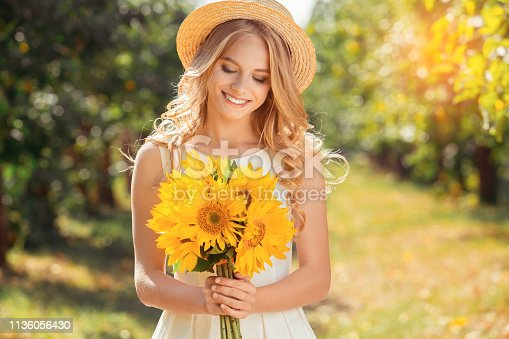 Young female blonde hair summer style concept farm